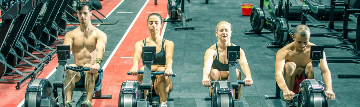 Concept 2 People Rowing indoors